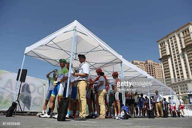 Riders stand as they queue to sign on to the start on the Junior Men's Road Race on Day Six of the UCI Road World Championships at The Pearl on...