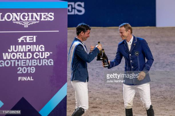 Riders Steve Guerdat and Peder Fredricson celebrate during the price giving ceremony for the 2019 Longines FEI Jumping World Cup Final during the...