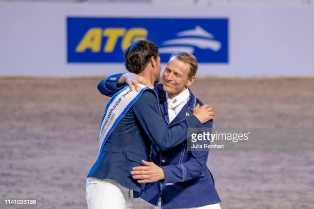 Riders Steve Guerdat and Peder Fredricson embrace during the price giving ceremony for the 2019 Longines FEI Jumping World Cup Final during the...