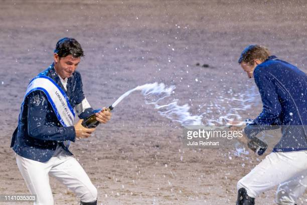 Riders Steve Guerdat and Peder Fredricson enage in a champagne battle during the price giving ceremony for the 2019 Longines FEI Jumping World Cup...