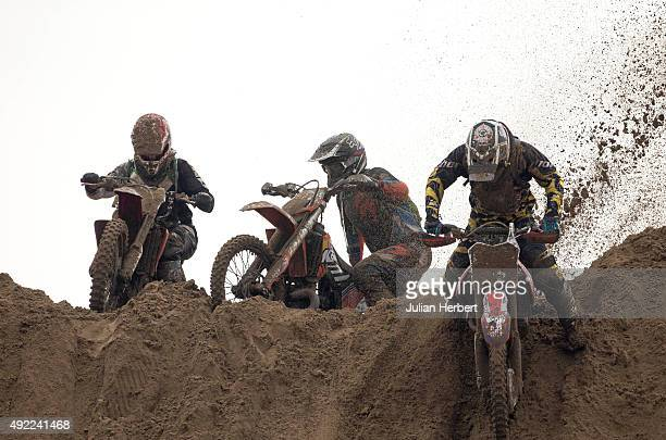 Riders tackle a jump during The Adult Solo Class during the RHL Weston Beach Race held on the beach at WestonSuperMare on October 11 2015 in...