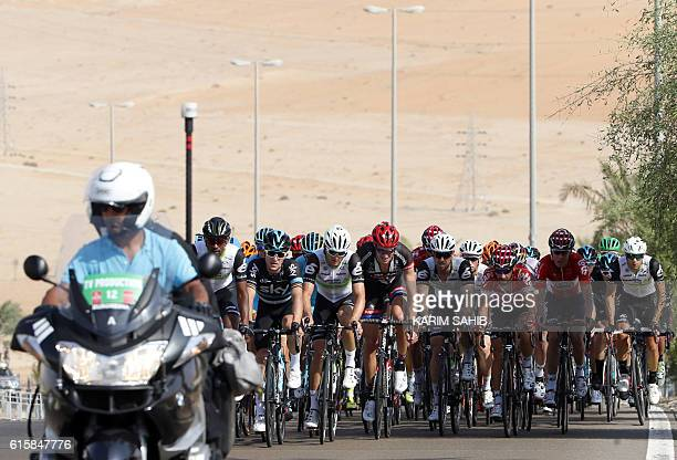 Riders take part in stage one of the 2016 Abu Dhabi Tour on October 20 2016 The first stage is a 147KM route starting and ending in Madinat Zayed /...