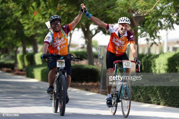 Riders take part in the Ride of Champions Cycling Festival on November 24 2017 in Doha Qatar