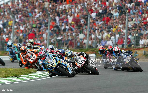 Riders take the first corner at the start of the first race from the British Round of the World Super Bike Championship on July 27, 2003 at Brands...