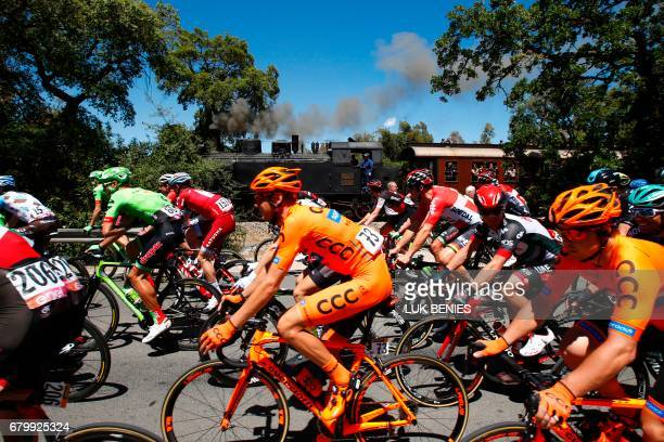 Riders take the start of the third stage of the 100th Giro d'Italia Tour of Italy cycling race from Tortoli to Cagliari on May 7 2017 in Sardinia /...