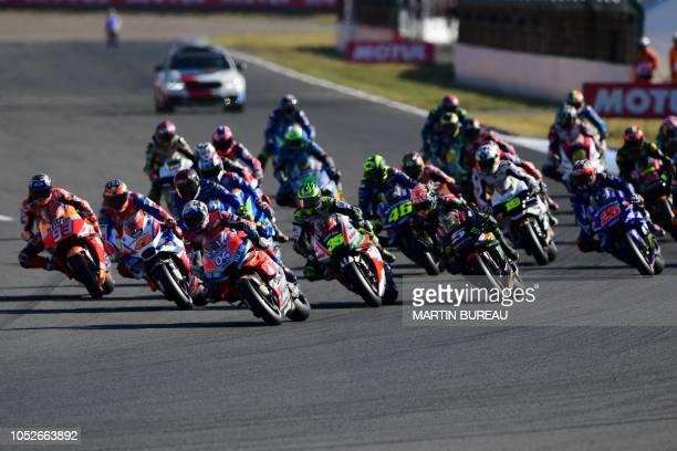 Riders take the start the MotoGP Japanese Grand Prix at Twin Ring Motegi circuit in Motegi, Tochigi prefecture on October 21, 2018. - Honda's Marc...