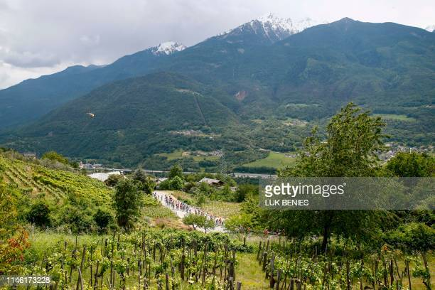 Riders takes part in stage fourteen of the 102nd Giro d'Italia - Tour of Italy - cycle race, 131kms from Saint Vincent to Courmayeur on May 25, 2019.