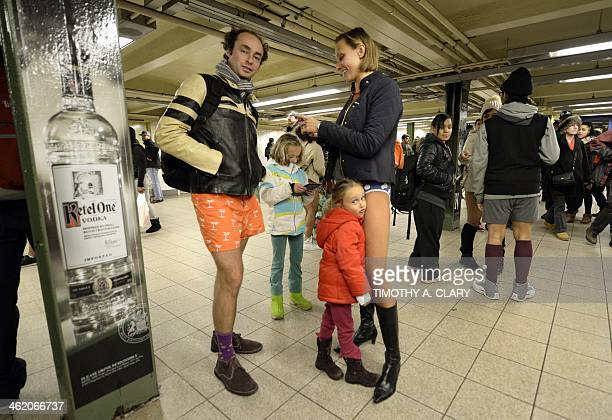 Riders wait for a train in the New York subway in their underwear as they take part in the 2014 No Pants Subway Ride on January 12 2014 Started by...
