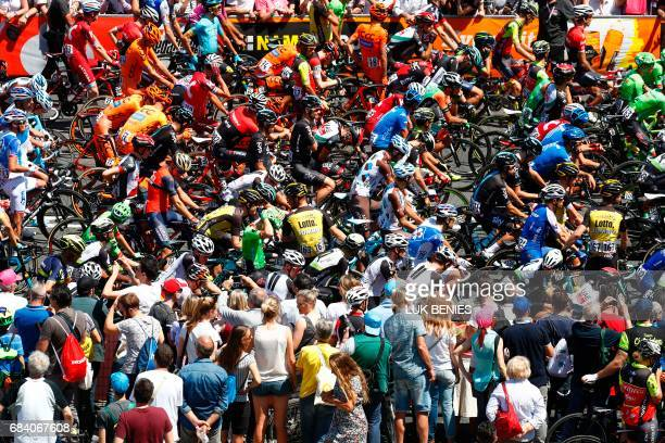 TOPSHOT Riders wait for the start of the 11th stage of the 100th Giro d'Italia Tour of Italy cycling race from Florence to Bagno di Romagna on May 17...