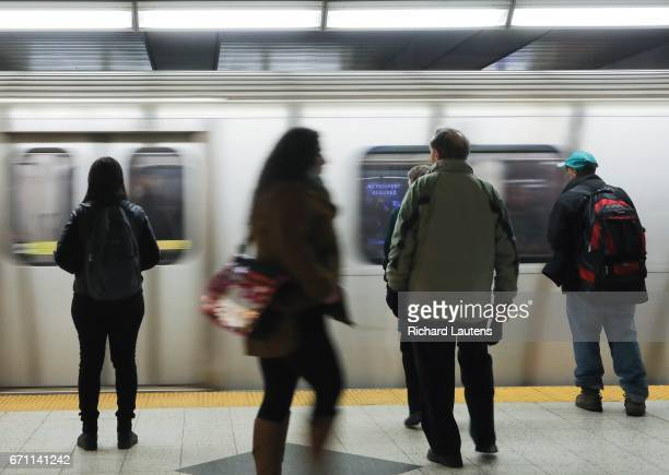 TORONTO ON APRIL 20 Riders wait patiently as the southbound train arrives at the Bloor/Yonge subway station The TTC has managed to drastically reduce...
