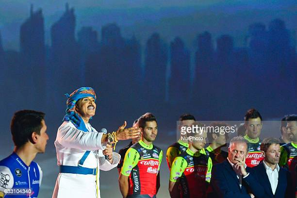 Riders watch a traditional music performance during the Official Opening Ceremony of the 2017 Dubai Tour at the outdoor amphitheatre in the Westin...