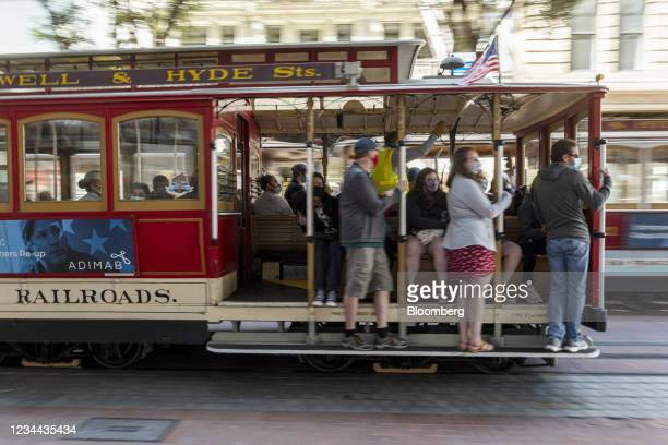 Riders wear protective masks on a cable car in San Francisco, California, U.S., on Tuesday, Aug. 3, 2021. San Francisco and its surrounding counties...
