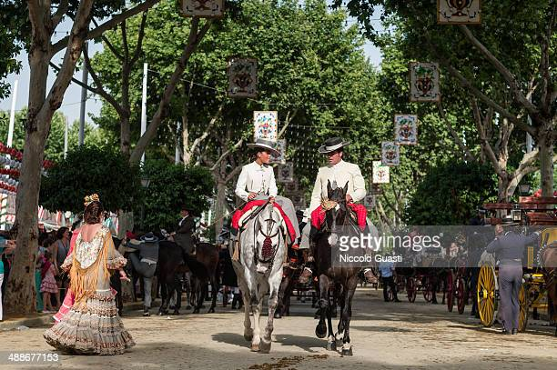 Riders wearing traditional Andalusian uniforms at the 'Feria de Abril 2014' on May 7 2014 in Seville Spain