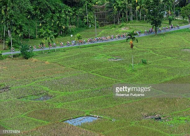 Riders were speeding their bike pass trough rice field in Batu Badindiang, Agam Regency. Stage 1 start from Bukittinggi to Bonjol, Pasaman. Stage 1...