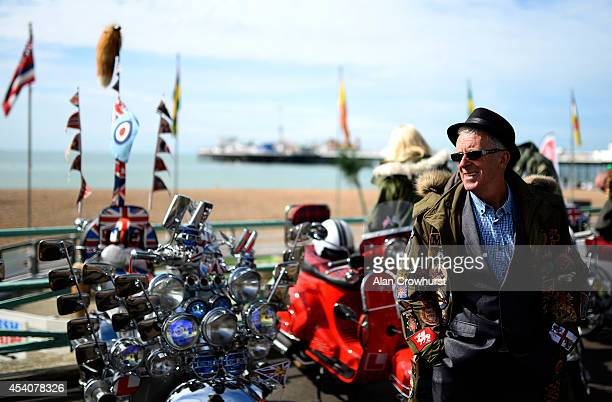 Riders with their scooters during the Brighton Mod weekender on August 24 2014 in Brighton England This August Bank holiday will see many Mods and...