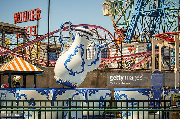 Rides at New York City's Coney Island Amusement Park include the Wonder Wheel and the teapot ride.
