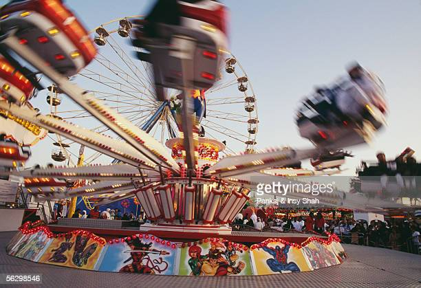 rides at the global village - global village stock pictures, royalty-free photos & images