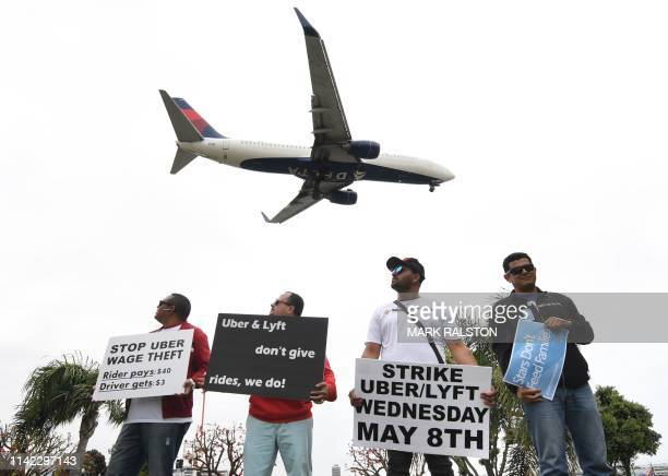TOPSHOT Rideshare drivers for Uber and Lyft stage a strike and protest at the LAX International Airport over what they say are unfair wages in Los...
