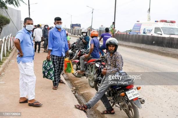 Ridesharing motorbike riders wait for passengers during the lockdown at the Gabtoli area during the covid-19 lockdown. Vehicle owners need to provide...