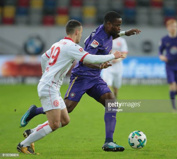 Ridge Munsy of Aue and Davor Lovren of Duesseldorf battle for the ball during the Second Bundesliga match between Fortuna Duesseldorf and FC...