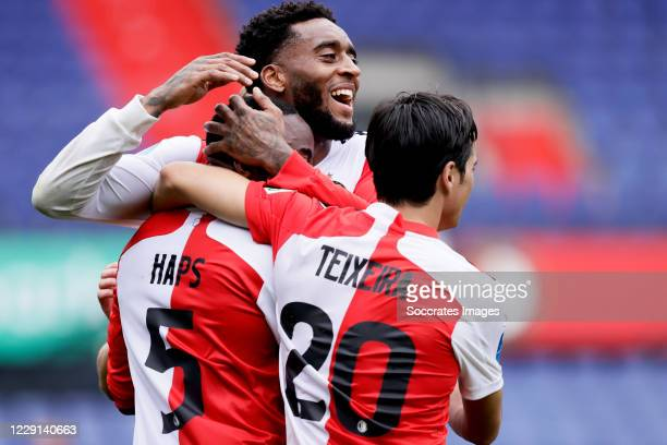 Ridgeciano Haps of Feyenoord celebrates 1-0 with Leroy Fer of Feyenoord, Joao Carlos Teixeira of Feyenoord during the Dutch Eredivisie match between...