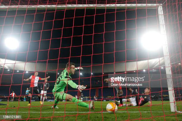 Ridgeciano Haps of Feyenoord scores his team's first goal past Igor Akinfeev of CSKA Moscow during the UEFA Europa League Group K stage match between...