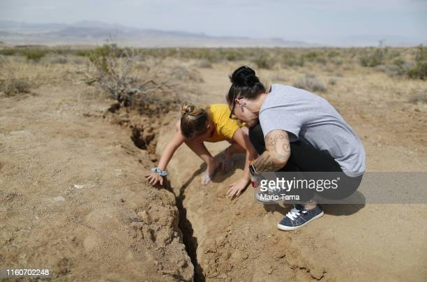 Ridgecrest residents inspect a recent fault rupture following two large earthquakes in the area on July 7 2019 near Ridgecrest California A 64...