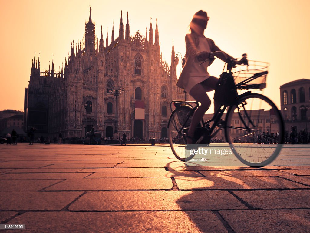 Riding A Bicycle In Milan City At Sunset : Stock Photo