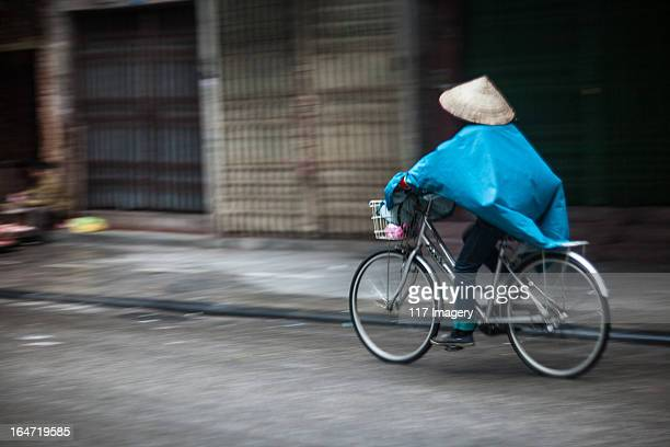 Riding a bicycle in old street, Hanoi, Vietnam