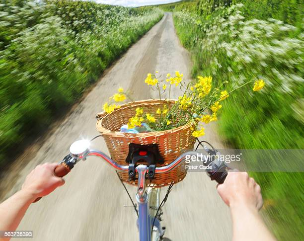 riding a bike through lane , just hands visible - basket stock pictures, royalty-free photos & images