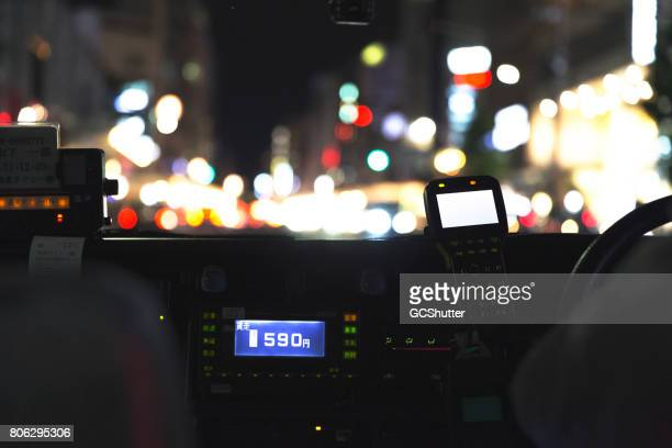 Riding a metered taxi in Kyoto at night