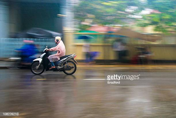 Riding A Motorcycle Through A Storm In Nha Trang, Vietnam