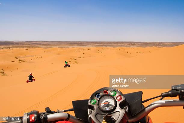 Riding a quad on first person in the dunes desert.