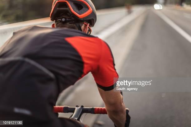riding a racing bicycle - bicicletta da corsa foto e immagini stock