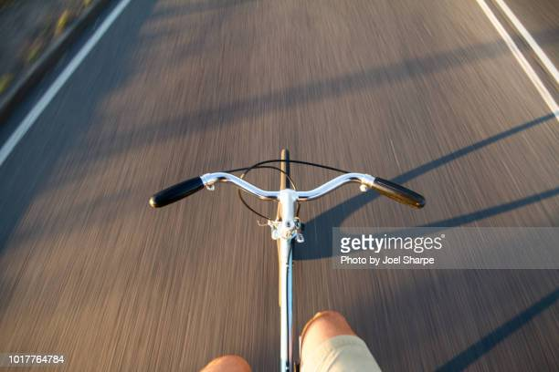 riding a road bike without hands - hands free cycling stock pictures, royalty-free photos & images