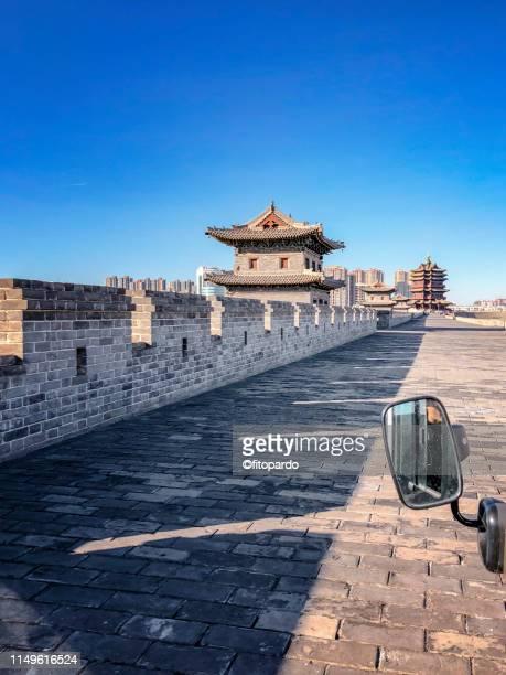 Riding a Tuk-tuk over the wall at Datong