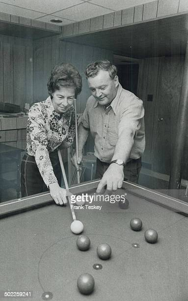 Riding a winning streak Bessie Jacobs gets some advice from her husband Bob as she lines up a billiard shot in the home they completely refurnished...