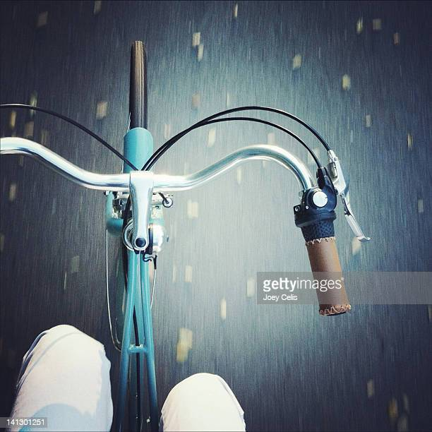Riding along on blue bike