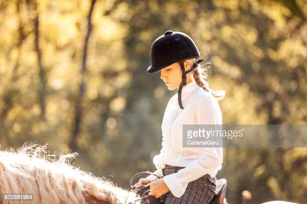 riding and petting the horse - riding hat stock pictures, royalty-free photos & images
