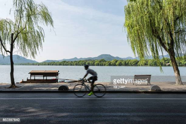 Riding bicycle by the West Lake,Hangzhou,China
