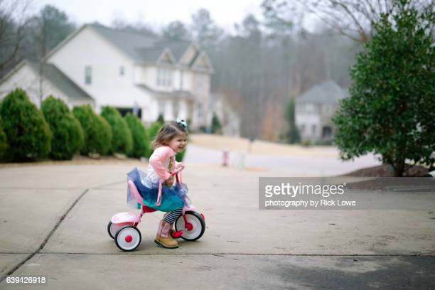 riding bike - tricycle stock pictures, royalty-free photos & images