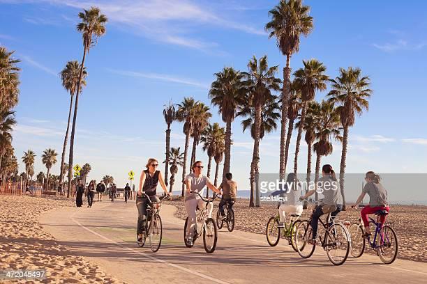 riding bikes at santa monica beach - santa monica stock pictures, royalty-free photos & images