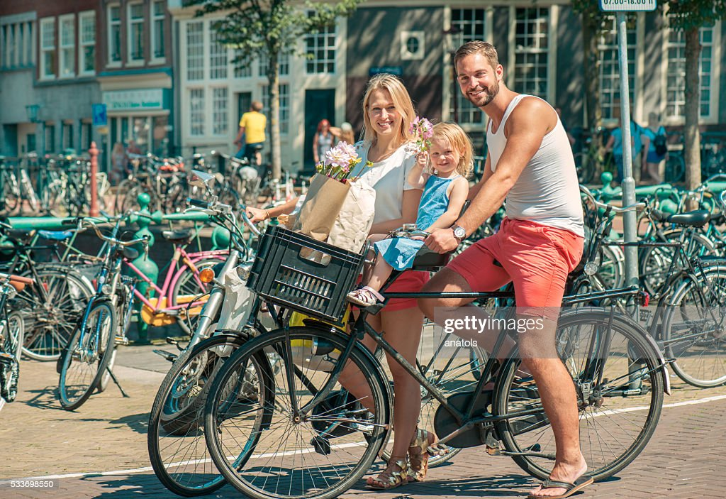 Riding bikes in Amsterdam : Stockfoto