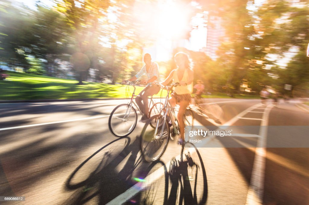 Riding bikes in Central Park, New York : Stock Photo