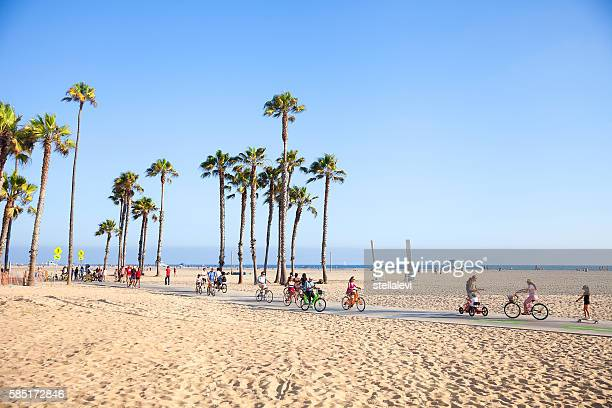 riding bikes in santa monica beach, california - santa monica stock-fotos und bilder