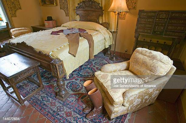 Riding boots and outfit displayed in guest room of Hearst Castle San Simeon California