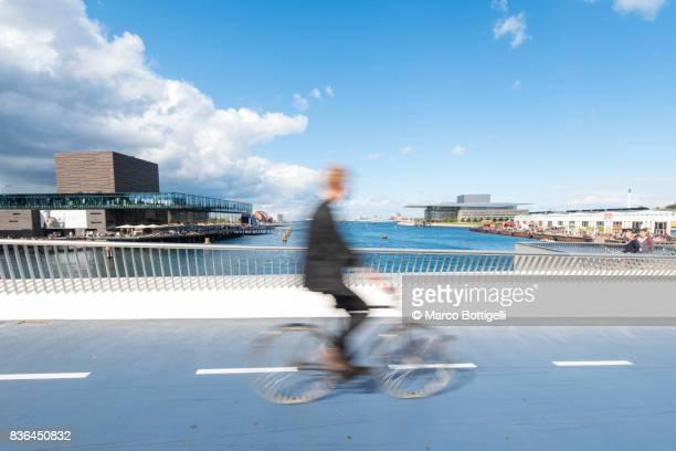 Riding bycicle in Copenhagen, Denmark.