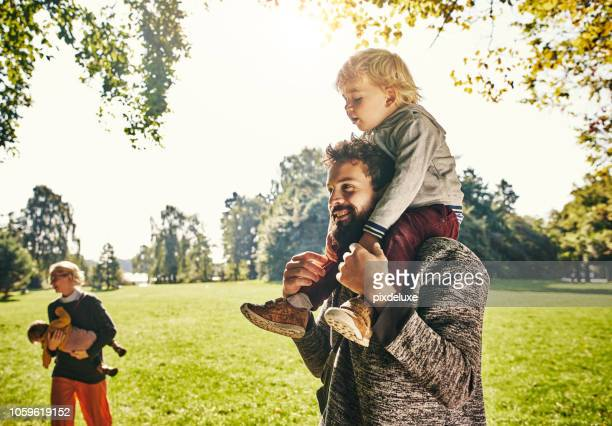 riding high on daddy's shoulders - image effect stock pictures, royalty-free photos & images