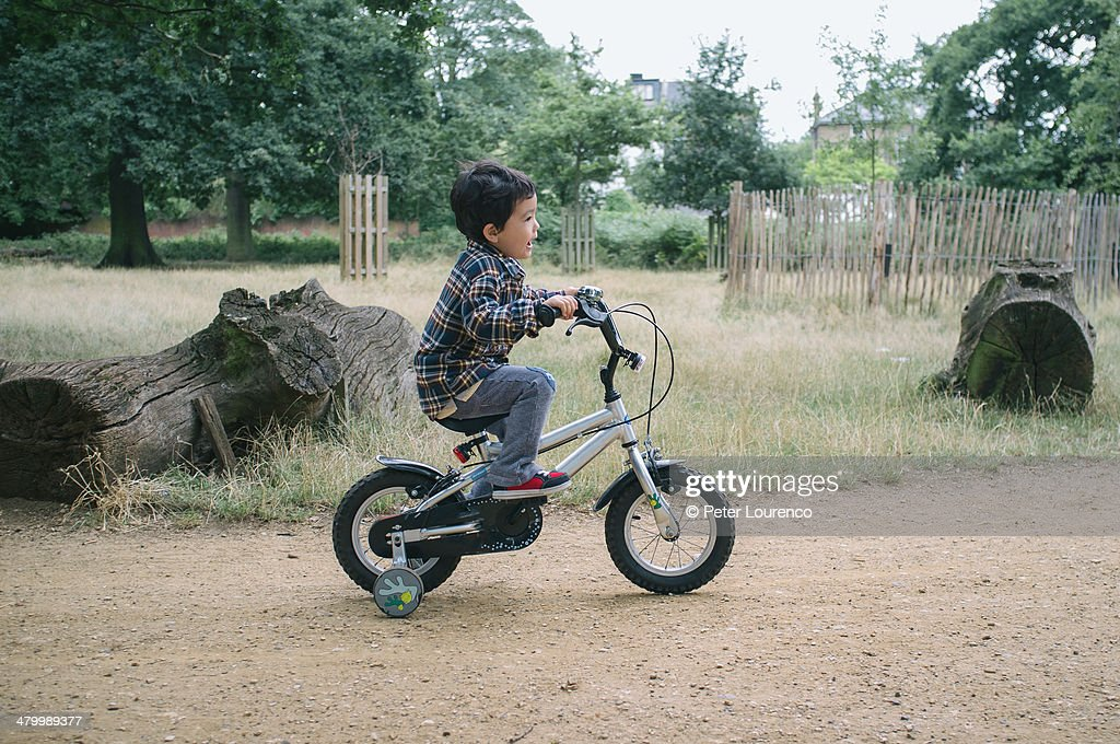 Riding his bike : Stock Photo