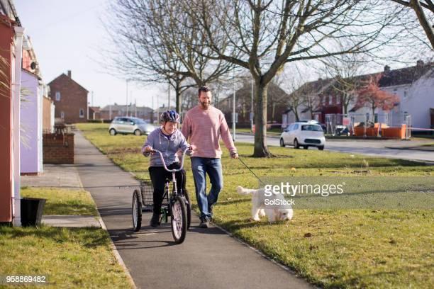 彼の自転車乗馬